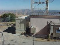 Sound attenuated, unmanned, remote mountain top generator module supporting a telecommunications repeater hut- all designed, built, and installed by North American Power & Controls. Inc